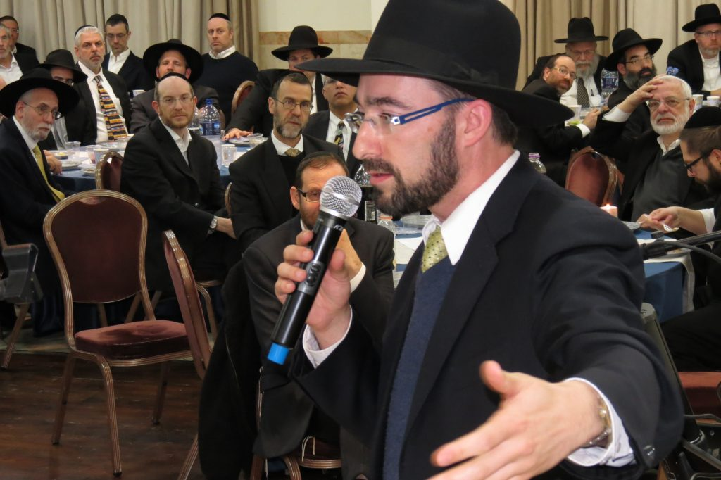 BTYA President Dovid Kallus speaking to the kehilla at the BTYA Melaveh Malkah
